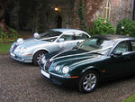 Silvery Blue and British Racing Green Jaguar S-Types at a wedding in November 2009