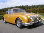 Metallic Gold 1967 Jaguar Mark 2 with chrome wire wheels