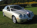 Modern Jaguar S-Type in Metallic Gold