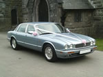 Modern Silver Jaguar Sovereign at a wedding in April 2012