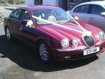 Jaguar S-Types in Metallic Red and Metallic Silver at a wedding on 28 April 2012